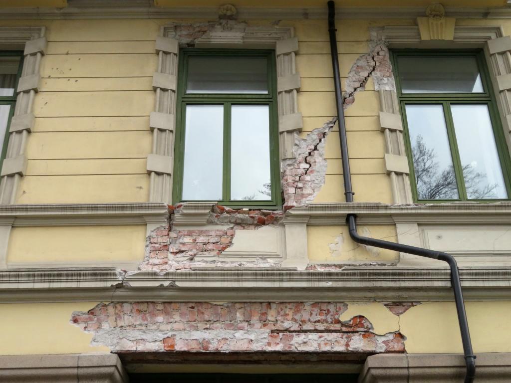 Oppussing av bygård med murfasade